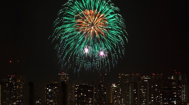 A spectral fireworks show over Waikiki at night