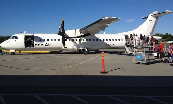 Passengers board an Island Air aircraft