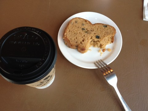 A plate of fresh zucchini bread and cup of coffee at Kissaten