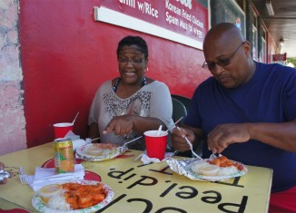 A couple enjoying garlic shrimp at a table