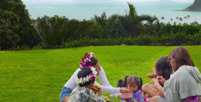 A family picnics at Kualoa Ranch