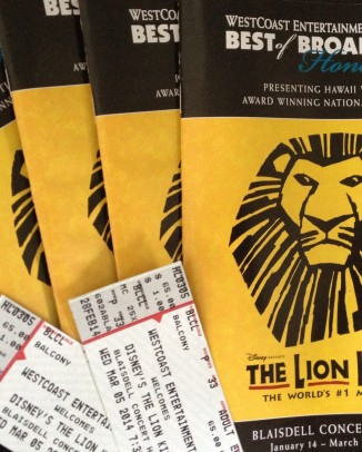several programs and tickets from The Lion King production