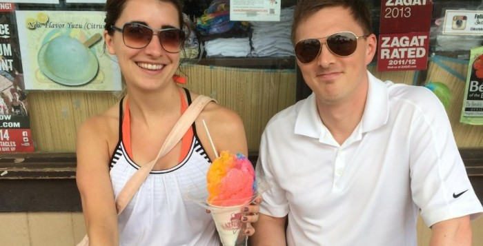 A woman and man with a colorful shave ice