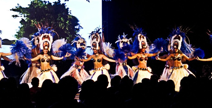 A group of tahitian dancers, dancing on stage