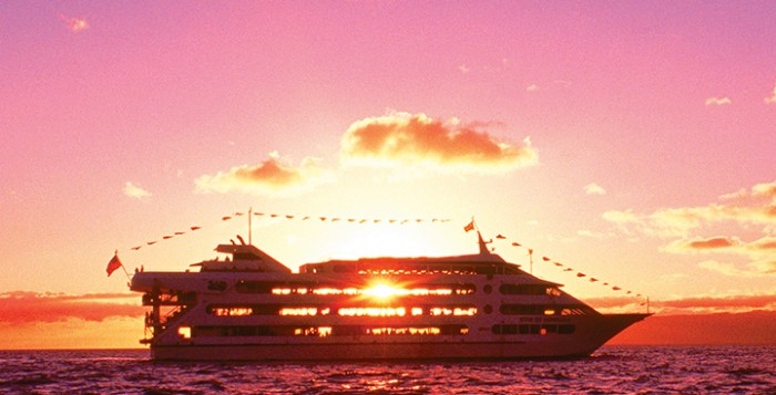 View of the Star of Honolulu ship with he sun setting behind it