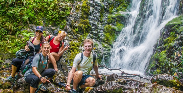 people standing in front of waterfall on Oahu