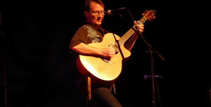 Stephen Inglis singing on stage before an audience