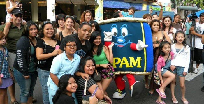 people posing with Spam Jam mascot