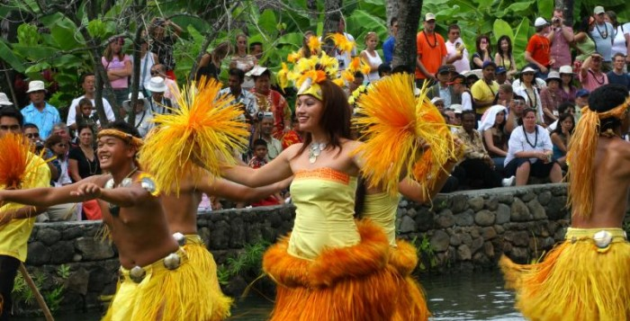 a group of Tahitian dancers performing