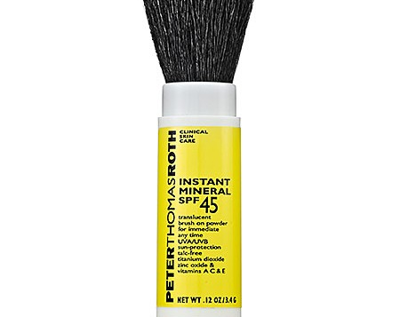 Powder Sunscreen Stick with brush exposed from Sephora