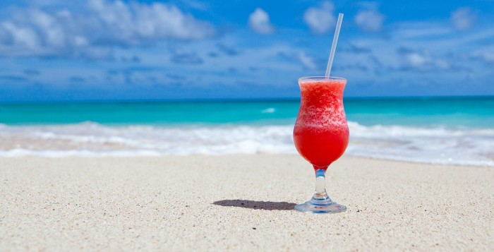 A frozen drink sits on the beach