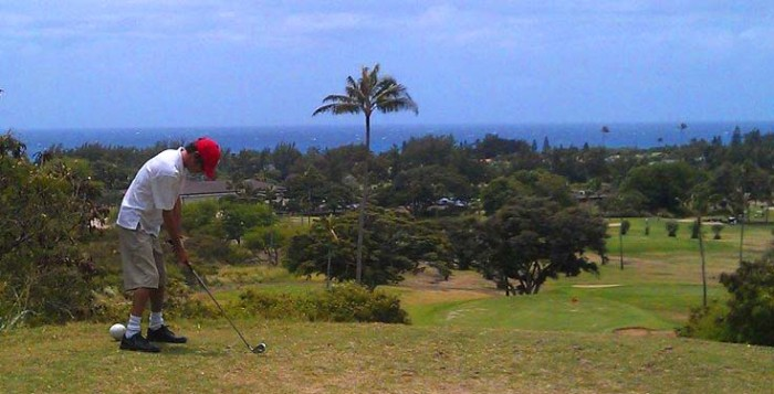 A man tees off at Hawaii Kai Golf Course