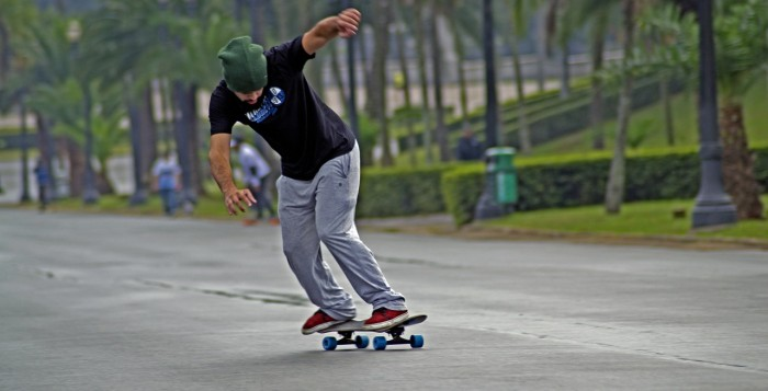 A skateboarder in the street