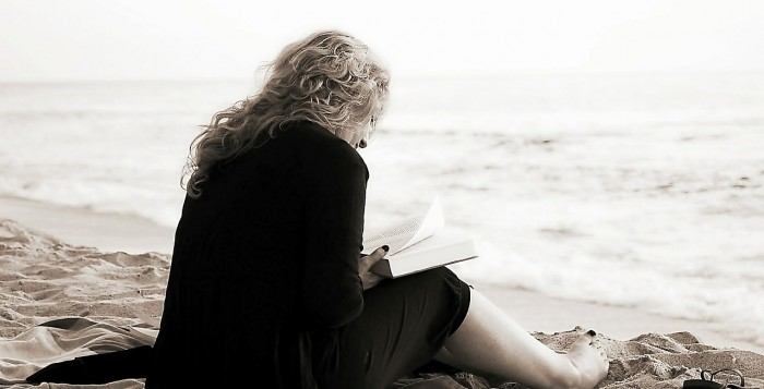 A woan reading on the beach