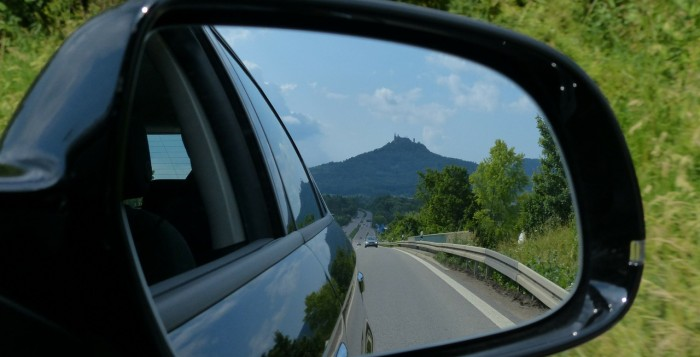 A mountain in a side-view mirror