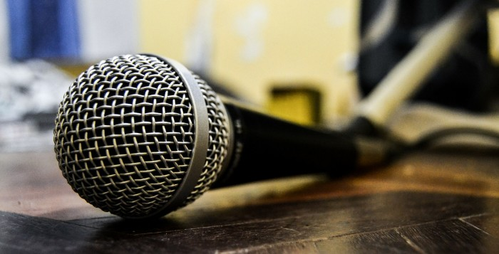 A microphone laying on a stage