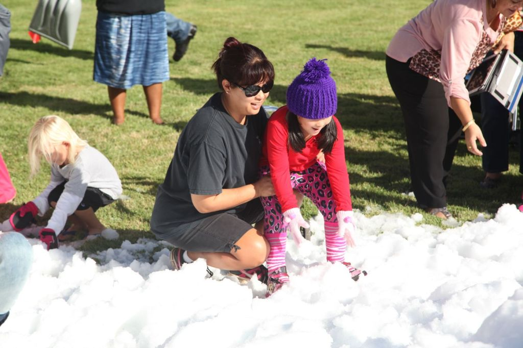 girl being helped into snow at Shriners hospital