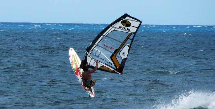 A windsurfer getting air