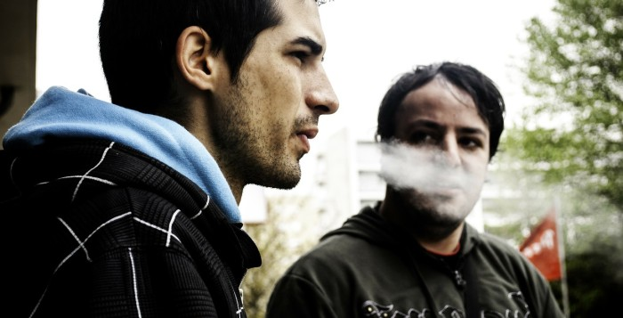 2 men smoking