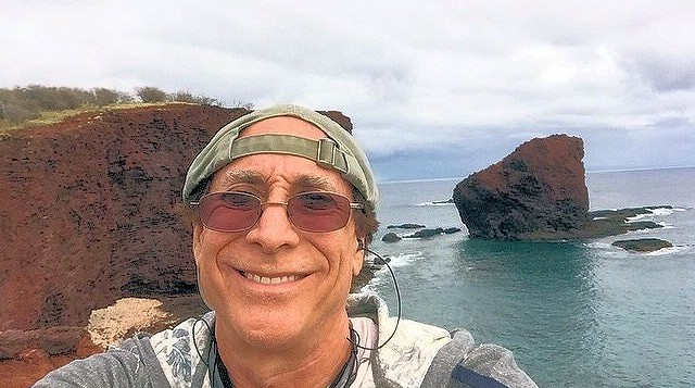 Bruce Fisher taking selfie at Huloope Bay on Lanai