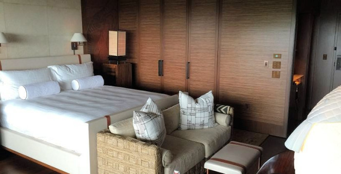 King bed and Sofa in renovated room at menele bay