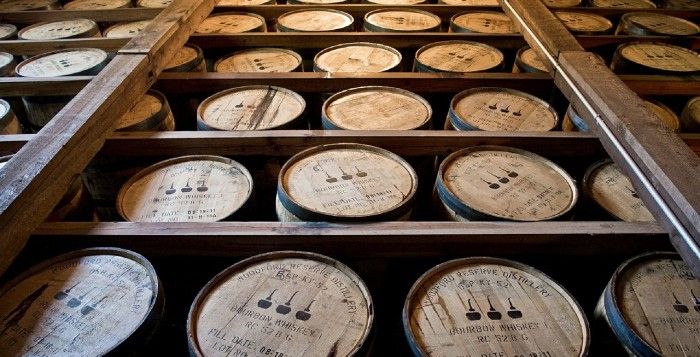 A wall of barrels filled with bourbon
