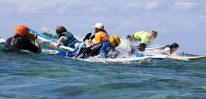 A picture of AccesSurf participants surfing.