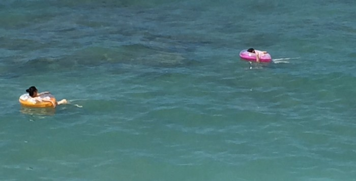 Two people in the ocean at Waikiki.