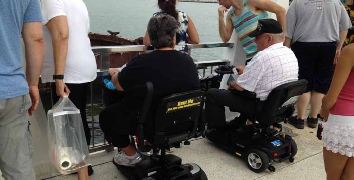 People in wheelchairs at Pearl Harbor