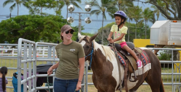 A child horseback riding