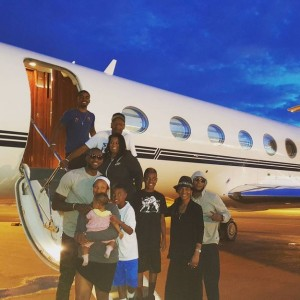 lebron james disembarking with his family from an airplane