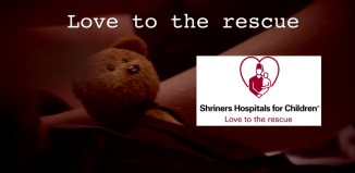 a teddy bear with the shriner's hospitals for children logo