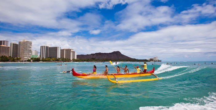 outrigger canoes on the water