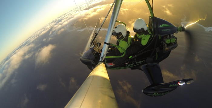 two people in a powered hang glider close-up
