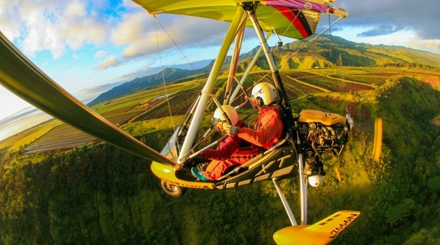 two people in a powered hang glider