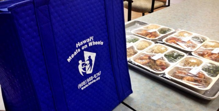 a meals on wheels bag next to food