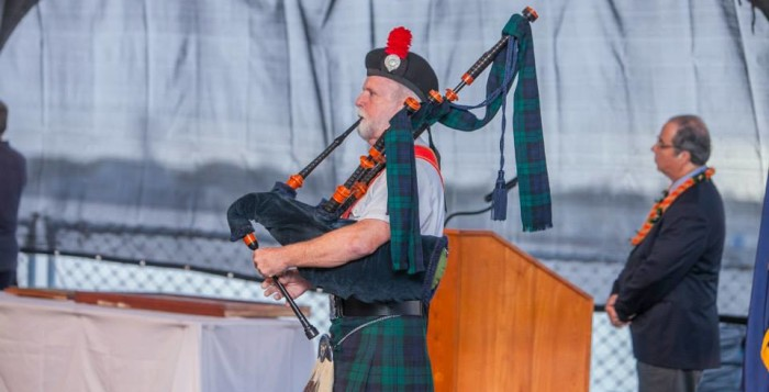 a man blowing bagpipes
