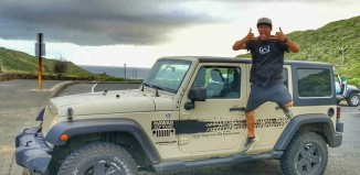 Man Jumping in front of Jeep