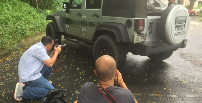 2 photographers taking pictures of Jeep Wrangler