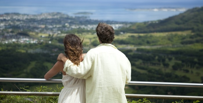a couple looking out at the Pali Lookout