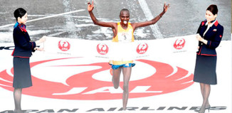 a man crossing the finish line of a marathon