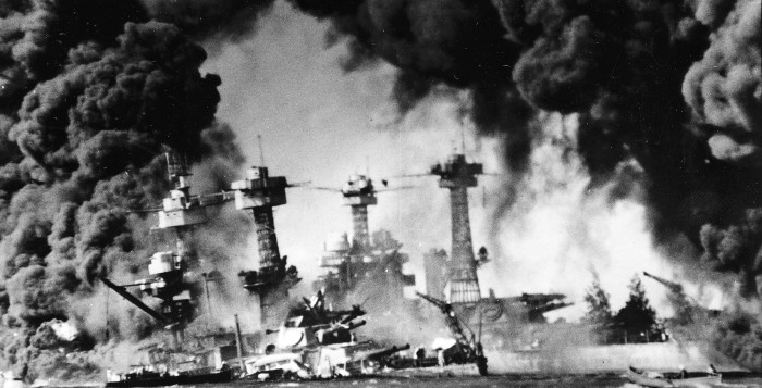 the battleship uss west virginia burning during the attack on pearl harbor