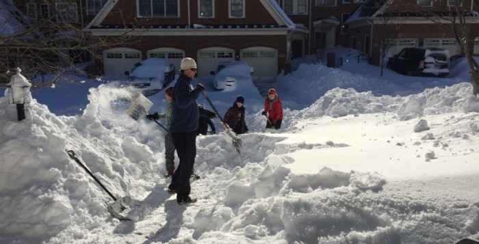 people shoveling snow