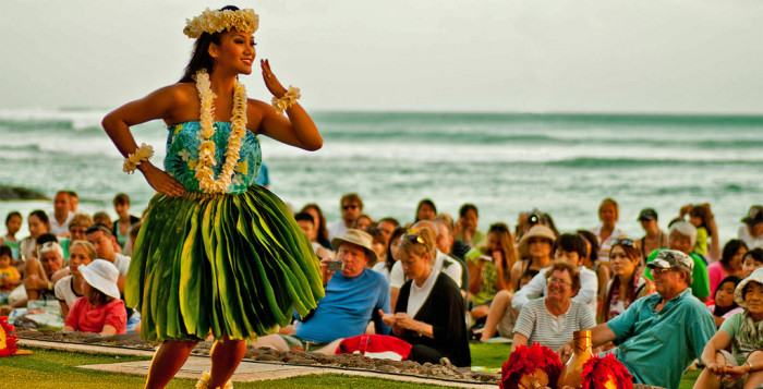 a hula dancer by the ocean