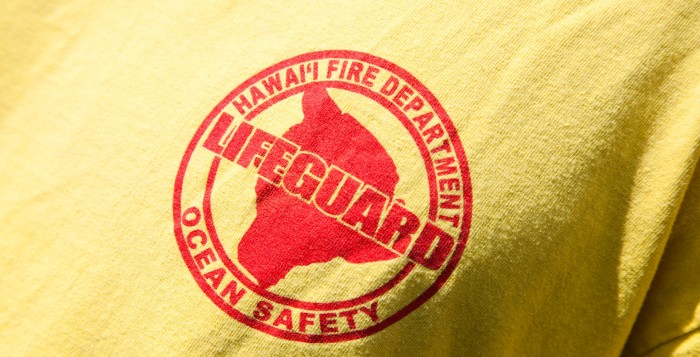 a shirt that says lifeguard on it