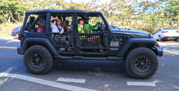 several people in a jeep