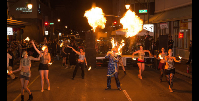dancers with fire on a street