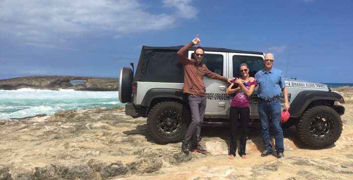 three people posing by a jeep at laie point