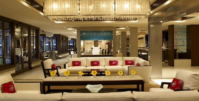 the lobby of a hotel with a white sofa