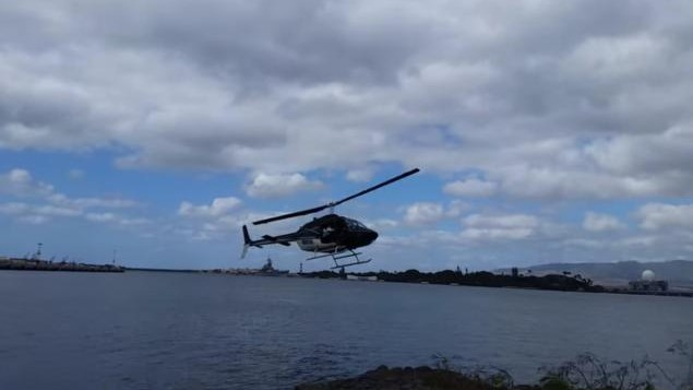 a helicopter above the ocean